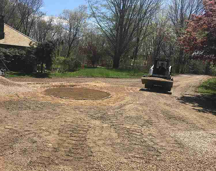 Driveway reshaping with island and peastone