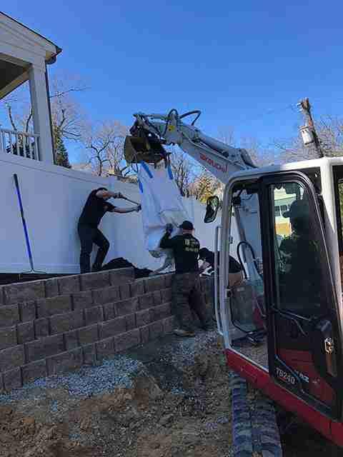 Excavator lifting materials
