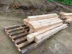 Freshly milled pine posts on pallets