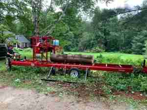 Pine log on milling machine to be milled.